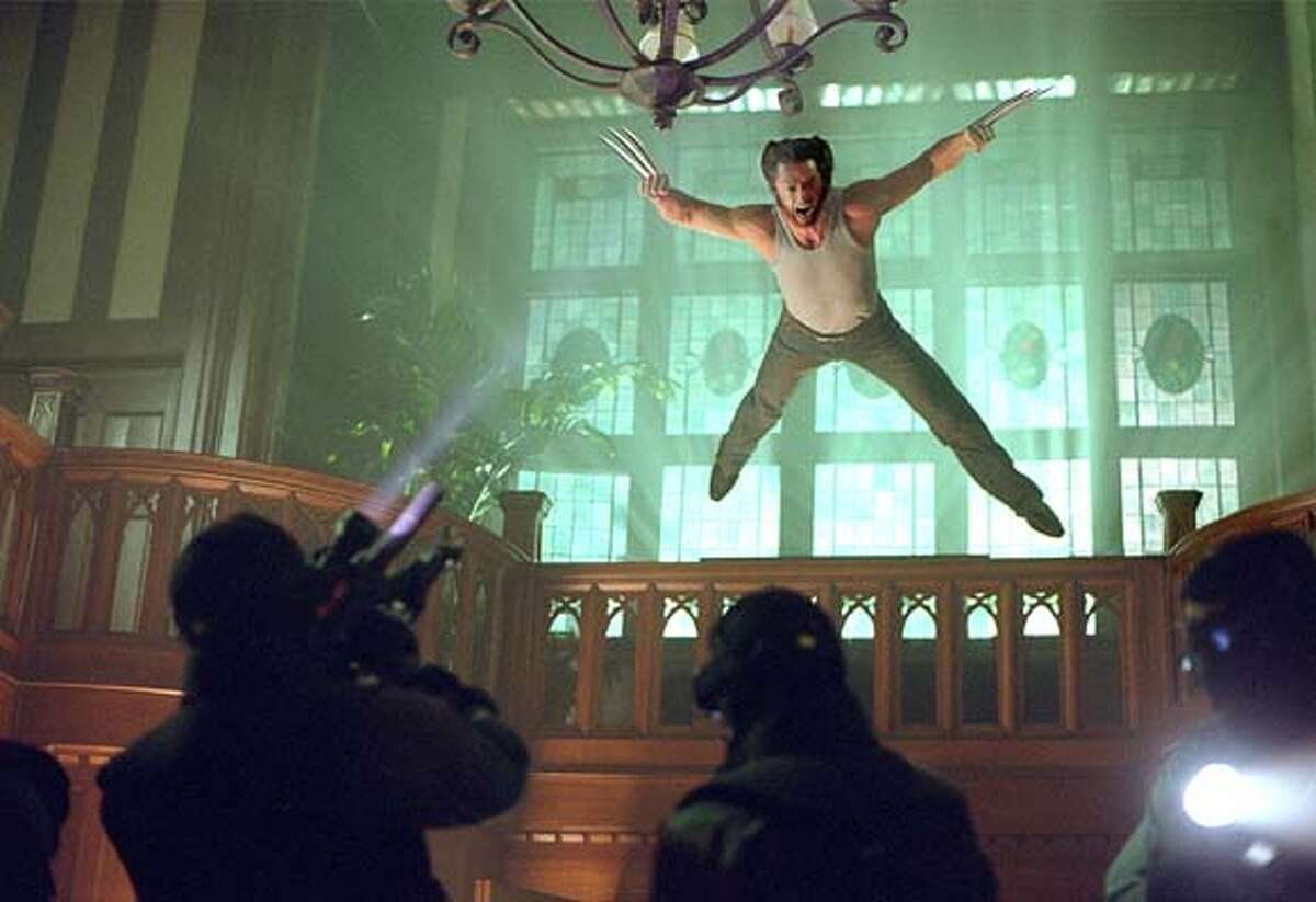 THIS IS A HANDOUT IMAGE. PLEASE VERIFY RIGHTS. Wolverine's ( Hugh Jackman ) full of fury is unleashed when Xavier's school for gifted youngsters comes under attack in the 2003 twentieth Century Fox production of X-Men2 HANDOUT PHOTO/VERIFY RIGHTS AND USEAGE