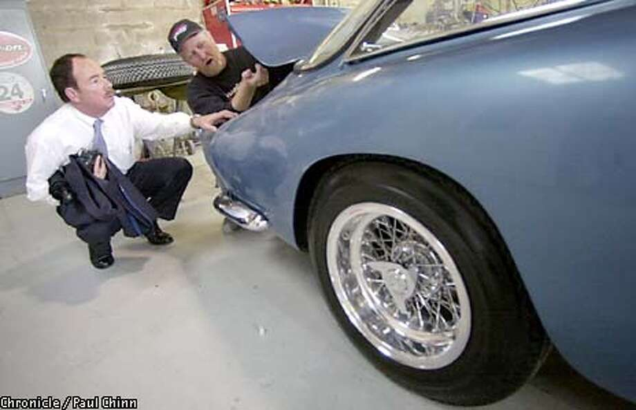 The car's owner Randy Hill (left) discussed the restoration project with shop owner Brian Hoyt. Finishing detail is applied to Hill's restored 1963 Ferrari Lusso - one of only 350 made by Ferrari - on 5/2/03 in Hayward. PAUL CHINN / The Chronicle Photo: PAUL CHINN