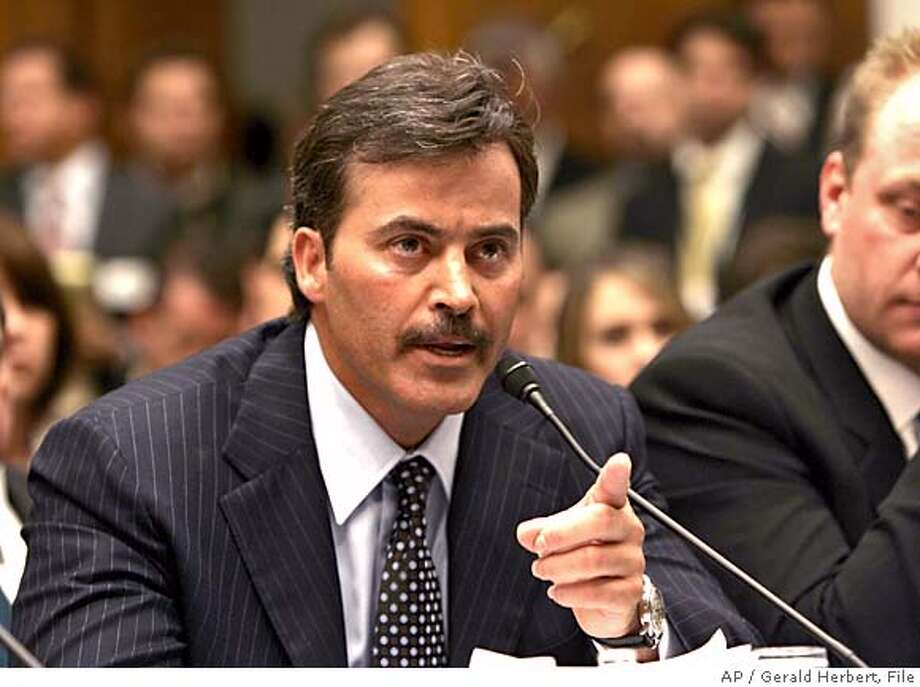 """** FILE ** Baltimore Orioles first baseman Rafael Palmeiro testifies on Capitol Hill in this March 17, 2005 file photo. Palmeiro was suspended 10 days for violating Major League Baseball's steroids policy Monday Aug. 1, 2005, nearly five months after emphatically telling Congress that """"I have never used steroids. Period."""" (AP Photo/Gerald Herbert, Files)) MARCH 17, 2005 FILE PHOTO Photo: GERALD HERBERT"""