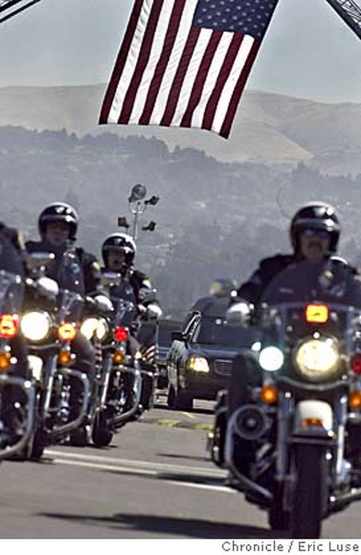 A motorcade withSan Leandro police officer Nels