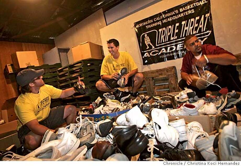 CHRISTINA KOCI HERNANDEZ/CHRONICLE  (L) Tyler Kreitz, (middle) Tony Freccero and (R) Lou Richie with the donated shoes. Triple Threat Academy leaders have started a basketball shoe assist program for kids overseas. They set a goal of 500 pairs of shoes - donated by the community - instead they got 2,500. The shoes are kept in watermellon barrels at an Oakland produce store at Jack London Square. Photo: CHRISTINA KOCI HERNANDEZ
