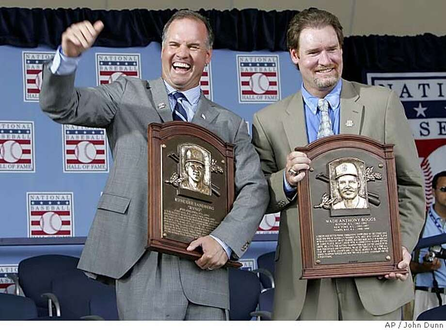 Ryne Sandberg, left, and Wade Boggs, right, the newest members of the National Baseball Hall of Fame, display their plaques at the end of the induction ceremonies Sunday, July 31, 2005, in Cooperstown, N.Y. Sandberg played his entire career with the Chicago Cubs while Boggs played for the Boston Red Sox, New York Yankees and Tampa Bay Devil Rays. (AP Photo/John Dunn) Photo: JOHN DUNN