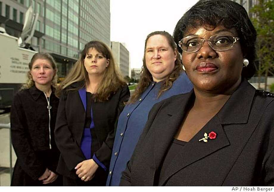 ** FILE ** Betty Dukes, right, lead plaintiff in a class-action suit against Wal-Mart, poses with fellow plaintiffs shortly before a hearing, in this file photo taken Sept. 24, 2003, in San Francisco. From right to left are Dukes, Patricia Surgenson, Stephanie Odle and Christine Kwapnoski. A federal appeals court ruled Tuesday, Feb. 6, 2007, that Wal-Mart Stores Inc., must face a class-action lawsuit alleging Dukes and other female employees, including some of her fellow plaintiffs shown here, were discriminated against in pay and promotions. (AP Photo/Noah Berger, File) SEPT. 24, 2003, FILE PHOTO. Photo: NOAH BERGER
