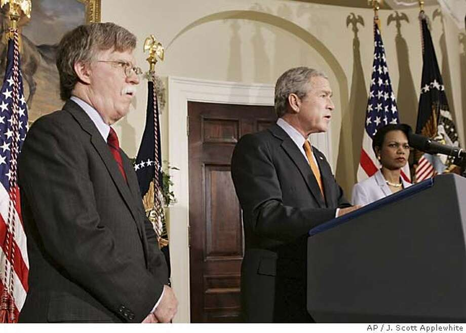 President Bush, center, stands with John Bolton, left and Secretary of State Condoleezza Rice as he announces Bolton's installation as United States ambassador to the United Nations Monday, Aug. 1, 2005 in Washington, D.C. Frustrated by Democrats, Bush sidestepped the Senate and installed Bolton as ambassador to the United Nations. (AP Photo/J. Scott Applewhite) Photo: J SCOTT APPLEWHITE