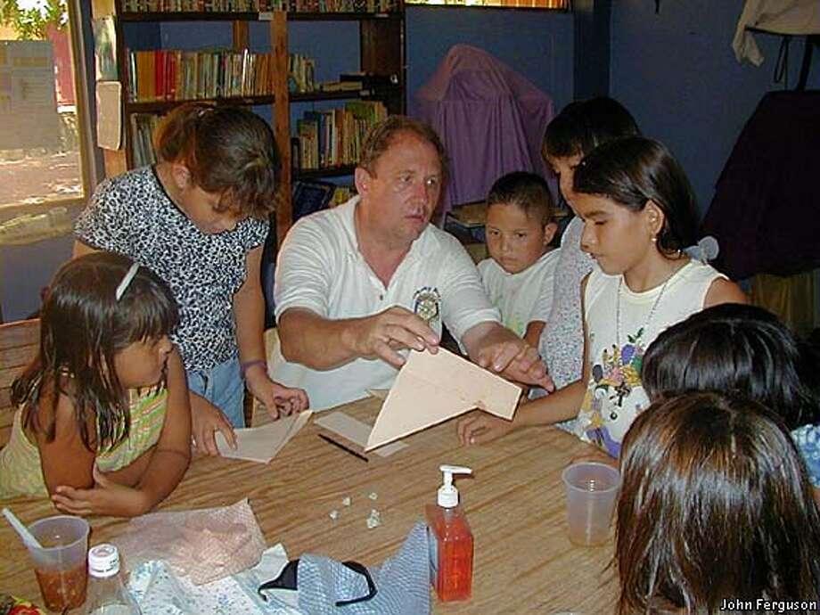 EBMEXICO25E: John Ferguson, Berkeley Rotary Club president, with village children. photo courtesy of John Ferguson