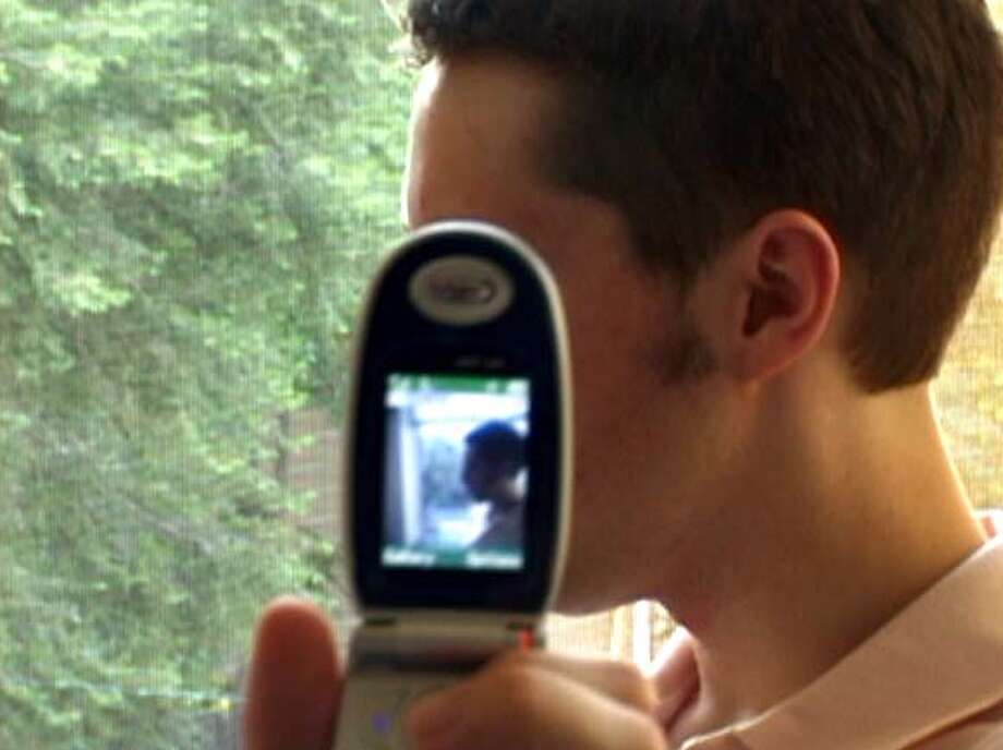 "Chris with his cameraphone, from ""LOL: The Movie."" Photo: LOL"