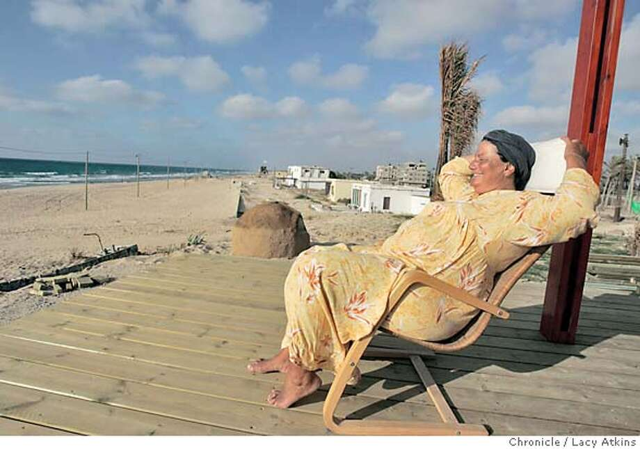 "Jeanine Nabe prepares to watch the sunset in her favorite place, a chair on her deck at her home in the settlement, Shirat HaYam also known as the ""Sound of the Sea"", in Gush Katif, June 9, 2005, in Gaza. Photographer Lacy Atkins Photo: LACY ATKINS"