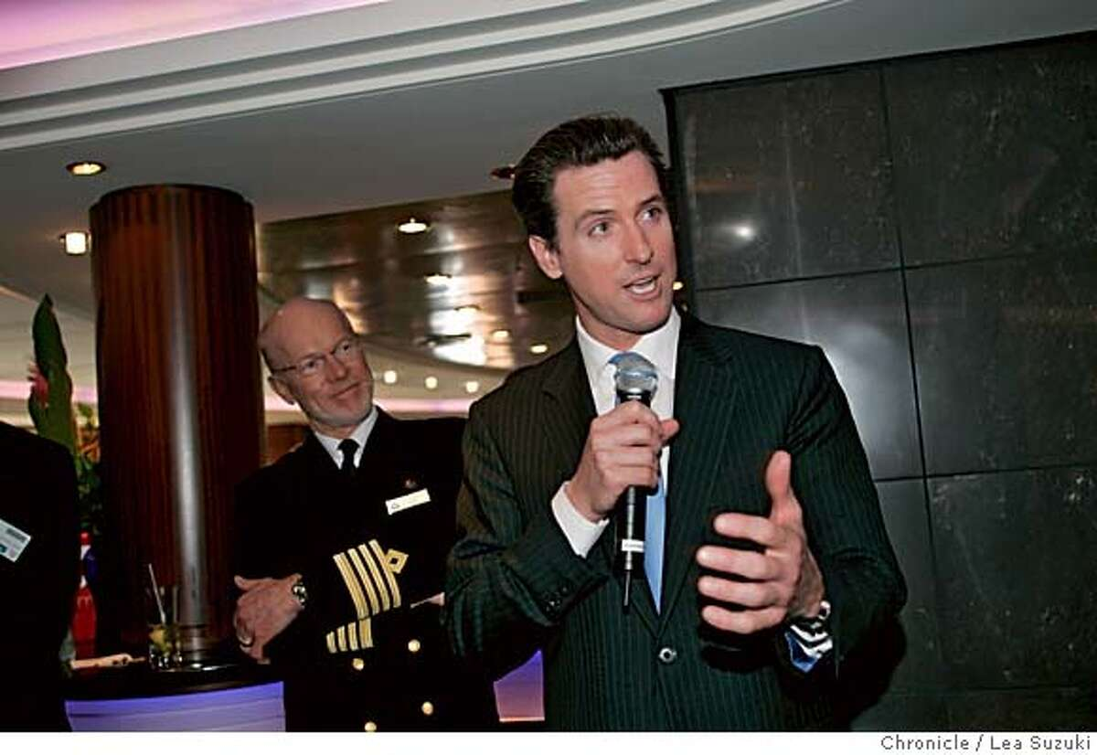 Mayor Gavin Newsom addresses the guests in the Commodore Club aboard the Queen Mary 2 before presenting Captain Christopher Rynd (left) with a proclomation. Media tours of the Queen Mary 2 and Mayor Newsom presents a proclomation to Captain Christopher Rynd on Monday, February 5, 2007. Photo by Lea Suzuki/The San Francisco Chronicle Photo taken on 2/5/07, in San Francisco, CA. **(themselves) cq.