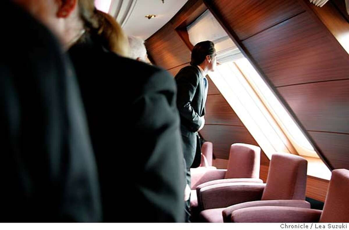 Mayor Gavin Newsom looks out a window at the Commodore Club before presenting Captain Rynd with a proclomation. Media tours of the Queen Mary 2 and Mayor Newsom presents a proclomation to Captain Christopher Rynd on Monday, February 5, 2007. Photo by Lea Suzuki/The San Francisco Chronicle Photo taken on 2/5/07, in San Francisco, CA. **(themselves) cq.