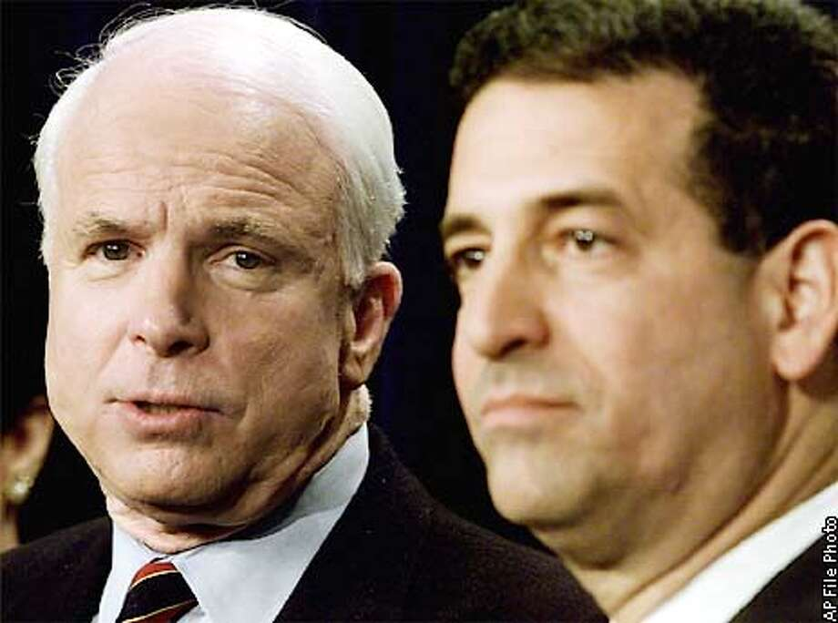 Sen. John McCain, R-Ariz, left, and Sen. Russ Feingold, D-Wis, right hold a news conference Monday, April 2, 2001 at the Capitol in Washington. The Senate approved landmark legislation Monday to reduce the influence of big money in political campaigns. The McCain Feingold bill passed in the Senate 59-41. (AP Photo/Joe Marquette), ALSO RAN 7/2/2001, 9/13/01 Photo: JOE MARQUETTE