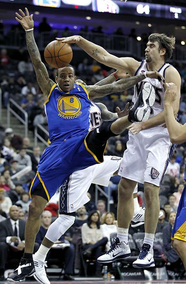 Golden State Warriors guard Monta Ellis (8) is blocked by New Jersey Nets center Mehmet Okur, right, of Turkey, during the third quarter of an NBA basketball game, Wednesday, Jan. 18, 2012, in Newark, N.J. The Nets won 107-100. (AP Photo/Julio Cortez) Photo: Julio Cortez, Associated Press