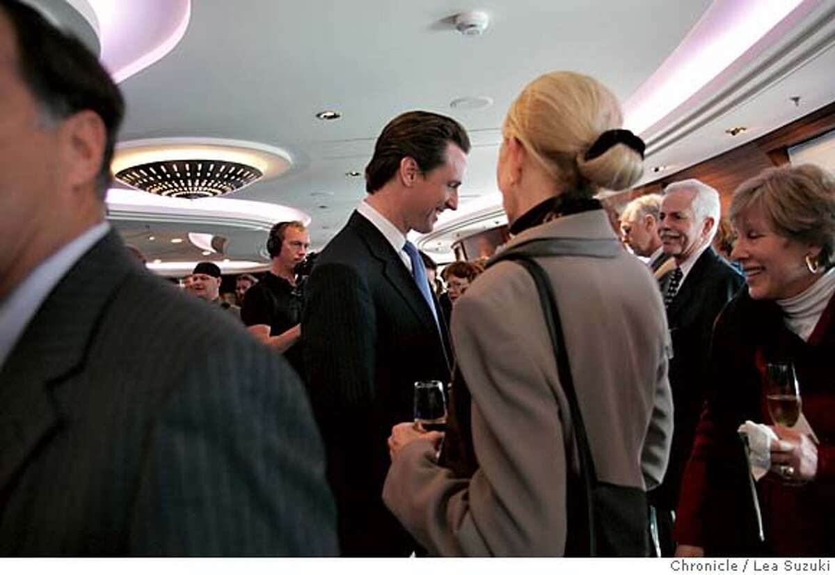queen06_223_ls.jpg Mayor Gavin Newsom talks with guests in the Commodore Club aboard the Queen Mary 2 before the Plaque and Key, a traditional ceremony when the boat comes into port, and Mayor Newsom's presenting of a proclamation. Media tours of the Queen Mary 2 and Mayor Newsom presents a proclomation to Captain Christopher Rynd on Monday, February 5, 2007. Photo by Lea Suzuki/The San Francisco Chronicle Photo taken on 2/5/07, in San Francisco, CA. **(themselves) cq.