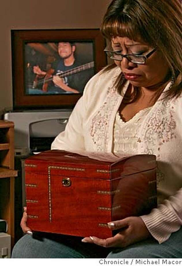 autopsy06_020_mac.jpg Selina Picon, holds the wooden urn that contains her son's heart, returned by the coroner. Selina has never opened the box, she keeps the box under her bed. Their son's death, from a rare heart defect, was the first shock for Joe and Selina Picon. the second was her discovery that the San Mateo County coroner had kept the heart of their 23 year old son, Nick, without notifying her, which is allowed by state law. After raising a big fuss, the coroner returned the heart to her and now the County Supervisors are working to change the law on the statewide level. Photographed in, San Francisco, Ca, on 2/2/07. Photo by: Michael Macor/ San Francisco Chronicle Mandatory credit for Photographer and San Francisco Chronicle / Magazines Out Photo: Michael Macor