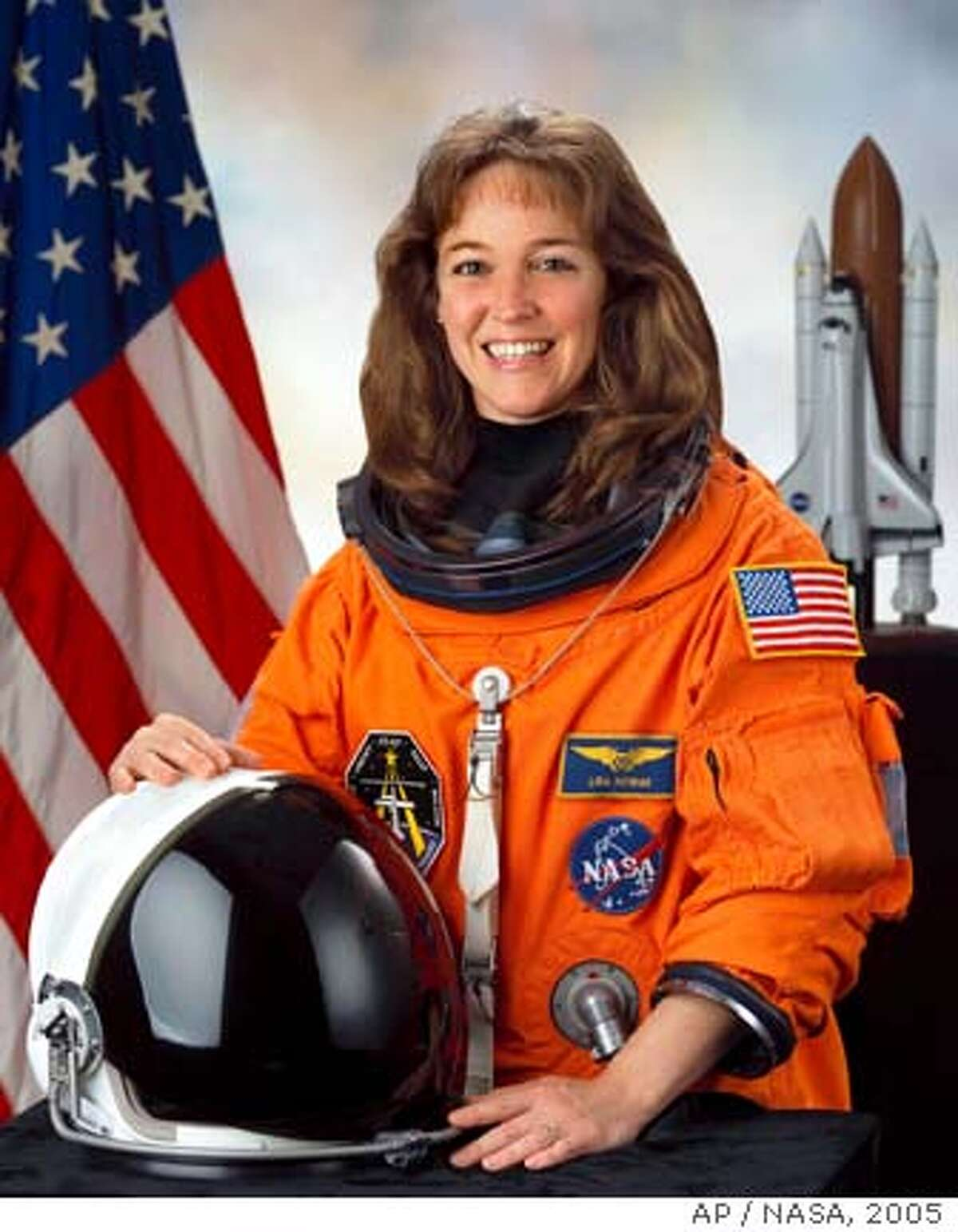 This photo provided by NASA shows astronaut and U.S. Navy Capt. Lisa M. Nowak, March 7, 2005 in Houston. Nowak was arrested Monday Feb. 5, 2007 for attempting to kidnap a woman she believed was romantically involved with another astronaut she was in love with, police said. Nowak, 43, who flew last July on a space shuttle mission to the international space station, was charged with attempted kidnapping, attempted vehicle burglary with battery, destruction of evidence and battery. She was denied bail. (AP Photo/NASA)