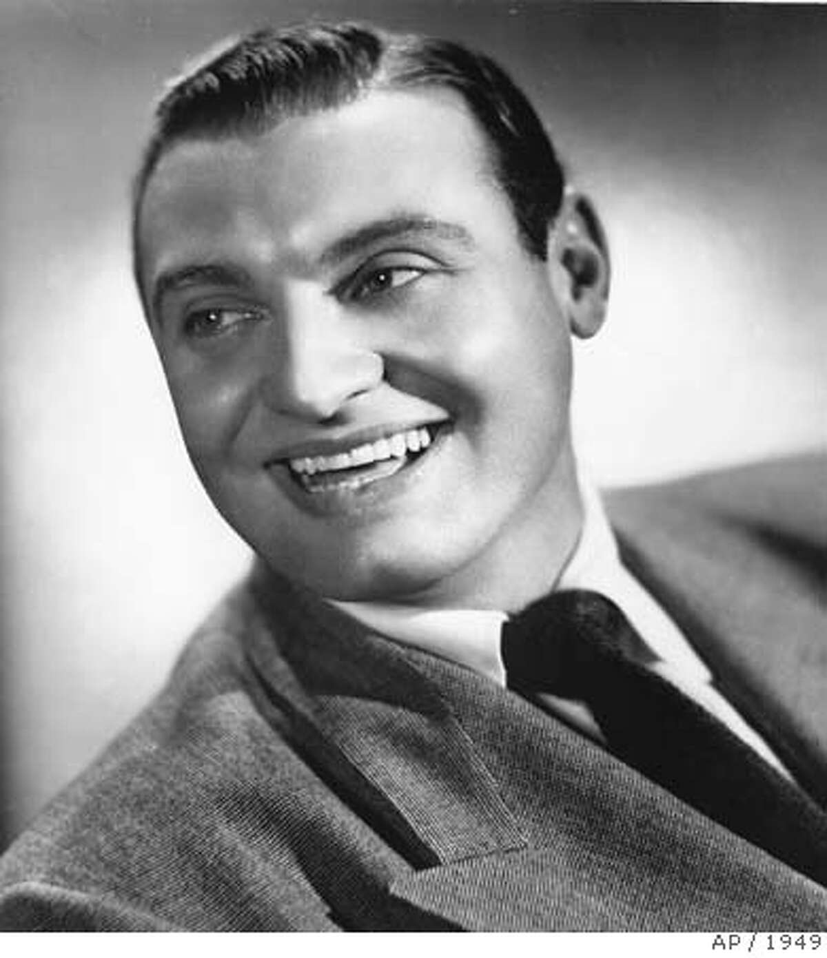 ** FILE ** Singer Frankie Laine is seen in this November 1949 file photo provided by General Artists Corporation. Laine, the big-voiced singer whose string of hits made him one of the most popular entertainers of the 1950s, died Tuesday, Feb. 5, 2007. He was 93. (AP Photo) NOVEMBER 1949 FILE PHOTO PROVIDED BY GENERAL ARTISTS CORPORATION