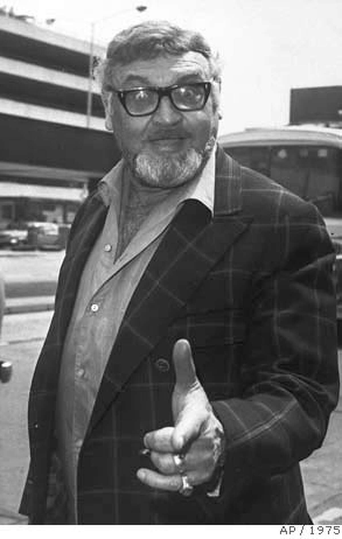 ** FILE ** Singer Frankie Laine is seen in this June 9, 1975 file photo at Heathrow Airport as he returns home to California after an 8-week stay in Britain. Laine, the big-voiced singer whose string of hits made him one of the most popular entertainers of the 1950s, died Tuesday, Feb. 5, 2007. He was 93. (AP Photo/PA)