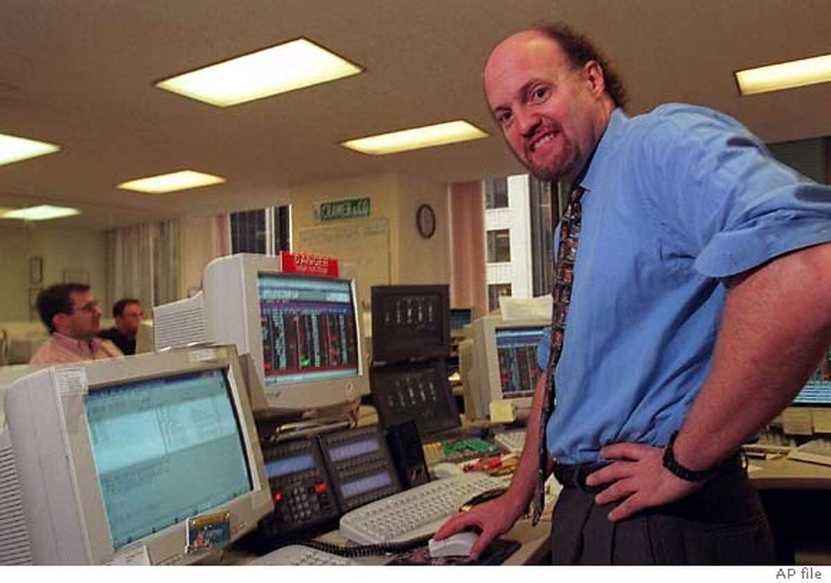 James J. Cramer works on the trading floor at his Wall Street firm, Cramer, Berkowitz & Co., in New York, Nov. 6, 1997. TheStreet.com is threatening to pull its television show off the Fox News channel claiming the dable network disparaged Cramer, a co-founder of TheStreet.com.(AP Photo/Rick Maiman) Ran on: 07-31-2005 Jim Cramer, seen at his trading firm in 1997, uses his years of experience to help viewers pick stocks.