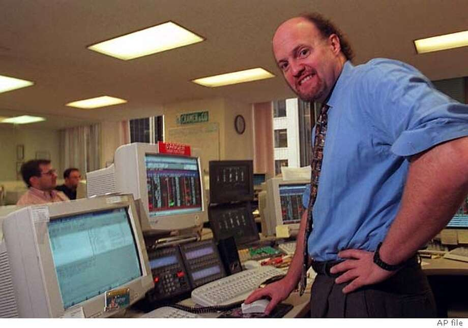 James J. Cramer works on the trading floor at his Wall Street firm, Cramer, Berkowitz & Co., in New York, Nov. 6, 1997. TheStreet.com is threatening to pull its television show off the Fox News channel claiming the dable network disparaged Cramer, a co-founder of TheStreet.com.(AP Photo/Rick Maiman) Ran on: 07-31-2005  Jim Cramer, seen at his trading firm in 1997, uses his years of experience to help viewers pick stocks. Photo: RICK MAIMAN