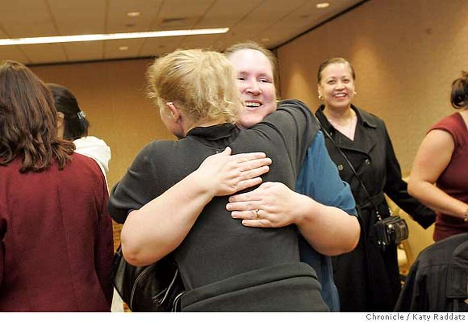 SHOWN: Lady facing the camera is plaintiff Patricia Surgeson, who is being hugged by Christine Kwapnoski, another main plaintiff. Patricia was late to the press conference because she was tied up in traffic from Sacramento. Federal appeals court upholds class-action status for a pay an promotion discrimination lawsuit filed against Walmart on behalf of 1.6 million women. The main plaintiffs and counsel will be at a press conference. These pictures were made on Tuesday, Feb. 6, 2007, in San Francisco, CA.  (Katy Raddatz/SF Chronicle) ** Christine Kwapnoski, Patricia Surgeson Photo: Katy Raddatz