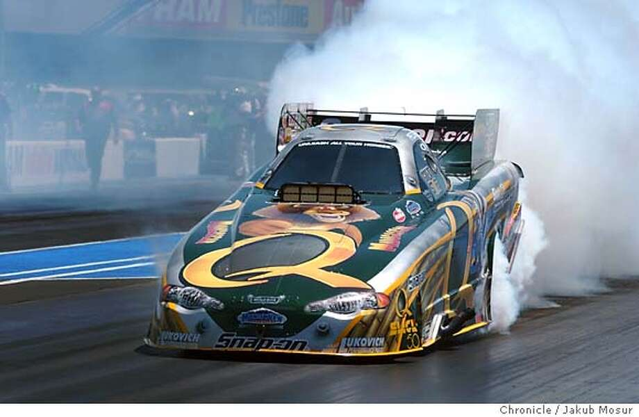 Tony Pedregon burns rubber before drag racing in the Funny Car section of the NHRA & Powerade Drag Racing Series at the Infineon Raceway in Sonoma.  Event on 7/30/05 in Sonoma. JAKUB MOSUR / The Chronicle Photo: JAKUB MOSUR