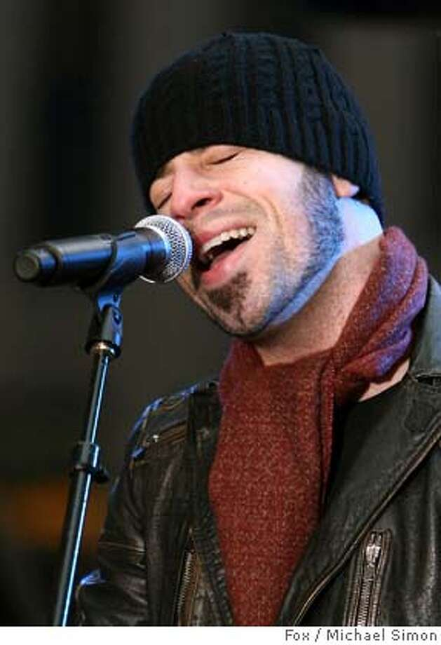 """In this photograph provided by Fox Television, former """"American Idol""""l finalist Chris Daughtry performs live on the debut of the """"The Morning Show with Mike and Juliet"""" national program on Fox Television, in New York, Monday, Jan. 22, 2007. (AP Photo/Michael Simon, Fox Television) ,PHOTOGRAPH PROVIDED BY FOX TELEVISION Photo: MICHAEL SIMON"""