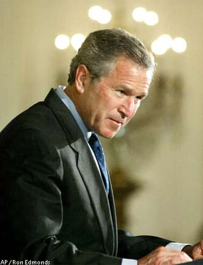 President Bush speaks in the East Room of the White House, Tuesday, April 29, 2003, on his AIDS initiative. Bush is giving his $15 billion global AIDS initiative a shove on Capitol Hill as lawmakers haggle over what emphasis the program should place on sexual abstinence. (AP Photo/Ron Edmonds) Photo: RON EDMONDS