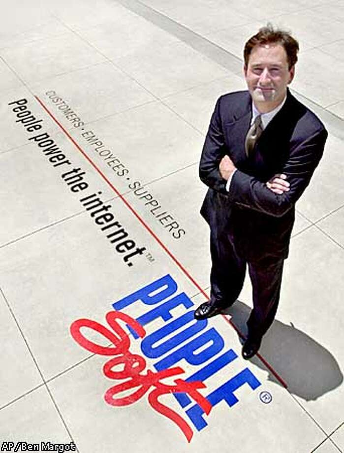 Craig Conway, CEO of PeopleSoft Inc., stands in front of his company's offices June 28, 2000, in Pleasanton, Calif. The company has unveiled new internet software applications and has stepped up marketing to compete with Oracle. (AP Photo/Ben Margot) Photo: BEN MARGOT