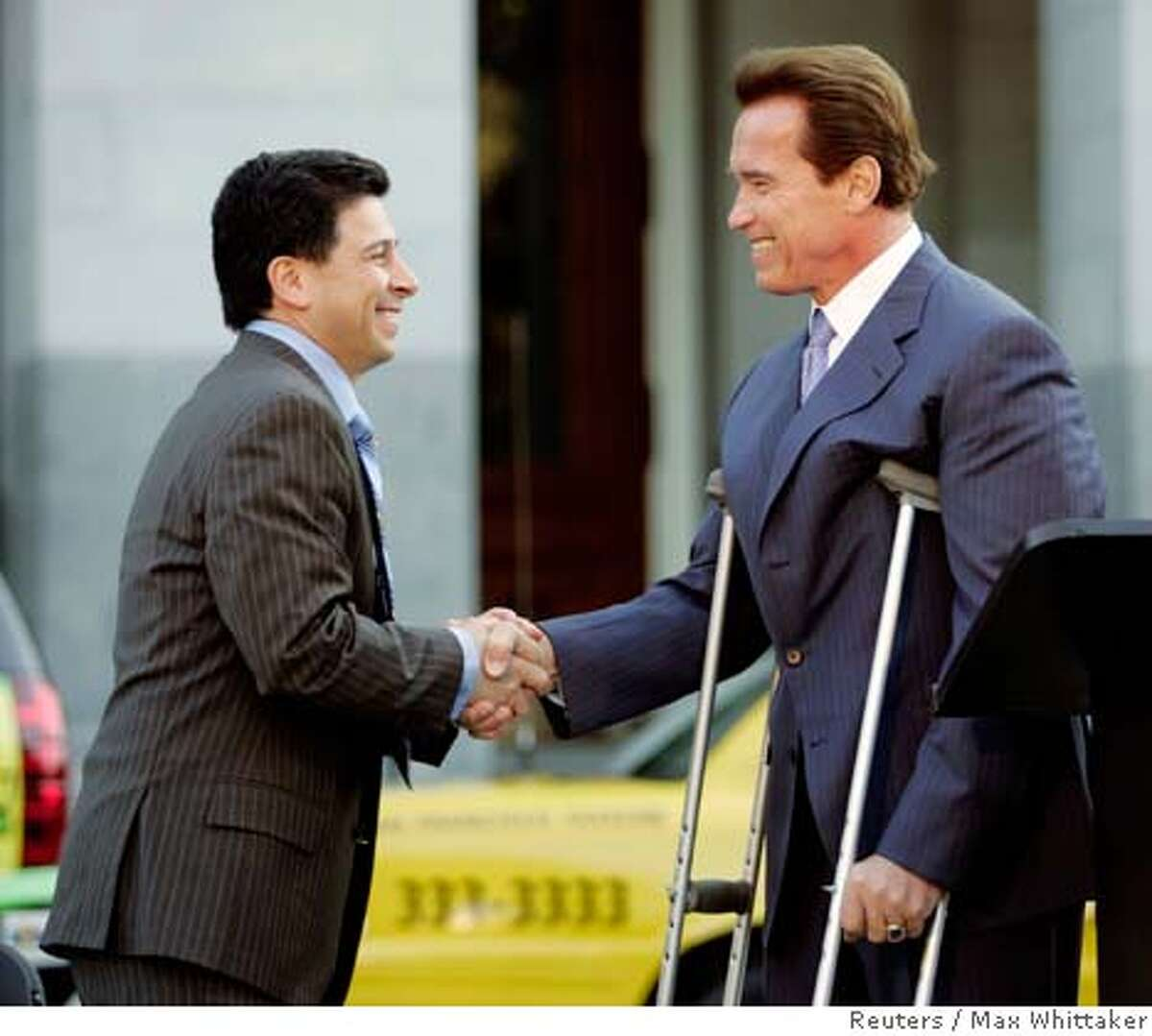 California Assembly Speaker, Democrat Fabian Nunez (L), greets Governor Arnold Schwarzenegger before he signs an executive order establishing a Low Carbon Fuel Standard (LCFS) for transportation fuels sold in California, at the State Capitol in Sacramento, California January 18, 2007. By 2020 the standard will reduce the carbon intensity of California's passenger vehicle fuels by at least 10 percent. REUTERS/Max Whittaker (UNITED STATES)