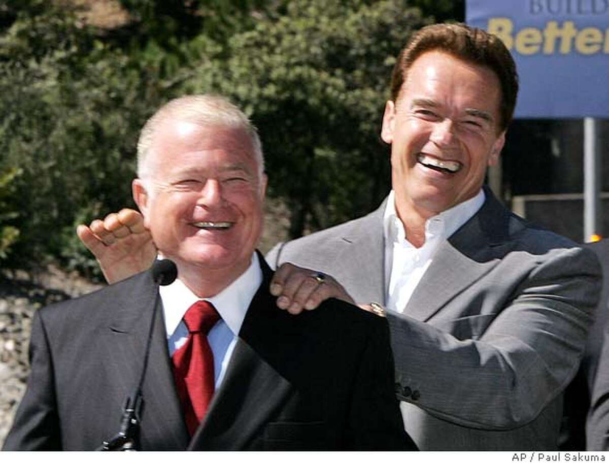 Gov. Arnold Schwarzenegger, center left, laughs with state Sen. Don Perata, D-Oakland, left, before he signed the largest of four public works bonds headed for the November ballot in Orinda, Calif., Tuesday, May 16, 2006. The transportation bond would provide $19.9 billion for highway, rail and port projects. Perata sponsored the bill. He is surrounded by other state elected officials in front of Caldecott Tunnel on Highway 24. (AP Photo/Paul Sakuma) Ran on: 05-17-2006 Gov. Arnold Schwarzenegger (at lectern) is flanked by officials outside the Caldecott Tunnel. Ran on: 05-17-2006 Gov. Arnold Schwarzenegger (at lectern) is flanked by officials outside the Caldecott Tunnel. Ran on: 05-17-2006 Ran on: 05-17-2006
