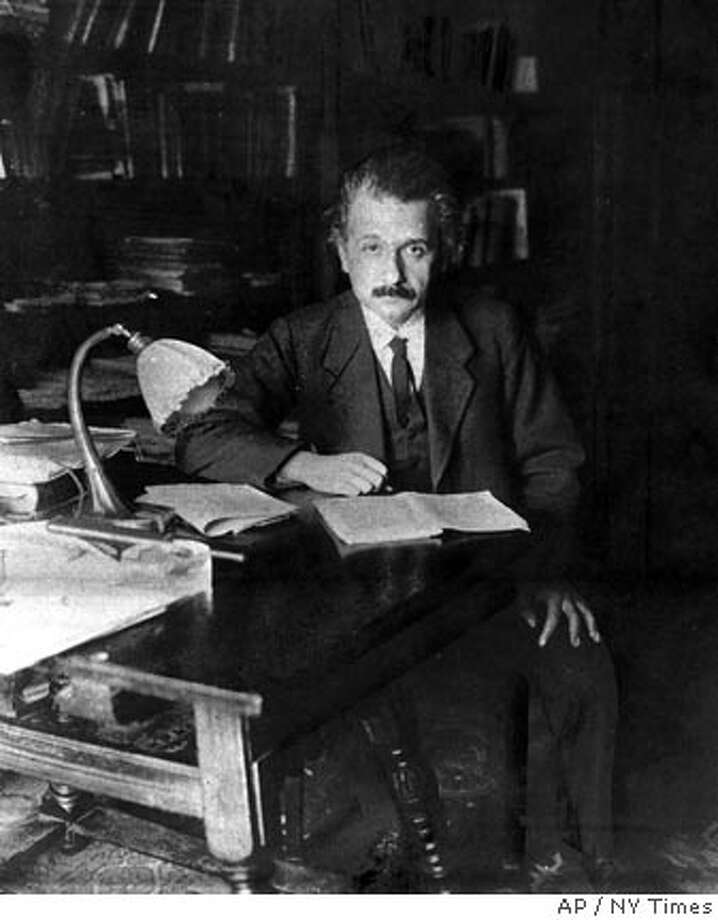 ** ADVANCE FOR SUNDAY, APRIL 17 **FILE**This is a 1919 file photo of physicist Albert Einstein in his study in Berlin, Germany, at the age of 40. (AP Photo/NY Times) Ran on: 04-17-2005  Albert Einstein plays his violin at his study in Princeton, above left; writes an equation in Pasadena relating to the density of the universe, center; and begins an Adirondacks vacation by sailing Saranac Lake.  Ran on: 02-04-2007  Albert Einstein was 40 in 1919 when this photo was taken in his study in Berlin. Photo: Ap