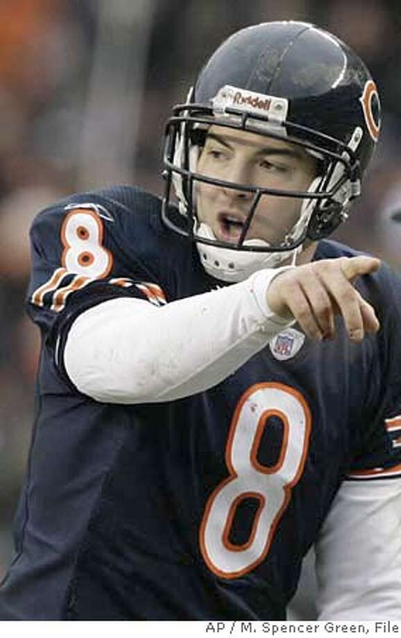 ** FILE ** Chicago Bears quarterback Rex Grossman calls out at the line against the Seattle Seahawks in the NFC divisional playoff football game in Chicago, in this Jan. 14, 2007 file photo. The Indianapolis Colts face the Chicago Bears in Super Bowl XLI in Miami on Sunday, Feb. 4, 2007. (AP Photo/M. Spencer Green) A JAN. 14, 2007 FILE PHOTO Photo: M. Spencer Green
