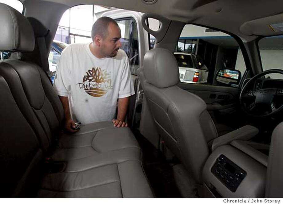 Marco Hernandez of South San Francisco looks at a 2005 Chevy Tahoe. Story about the sale incentives GM is offering on it's cars. Pictures from Stewart Chevy in Colma. John Storey Colma Event on 7/29/05  - Photo: John Storey