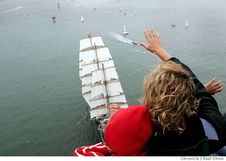 Standing on the Golden Gate Bridge, Sandy Graves and her daughter Riley, from Vacaville, wave to sailors aboard the Russian tall ship Pallada as it sailed under the Golden Gate Bridge on 7/28/05 in San Francisco, Calif. to kickoff a four-day maritime festival along the waterfront.  PAUL CHINN/The Chronicle Photo: PAUL CHINN