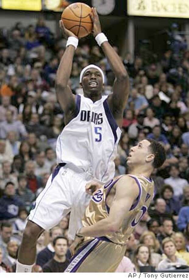Dallas Mavericks forward Josh Howard (5) attempts a shot over Sacramento Kings guard Mike Bibby (10) in the first half of a basketball game, Saturday, Jan. 27, 2007. (AP Photo/Tony Gutierrez) Photo: Tony Gutierrez