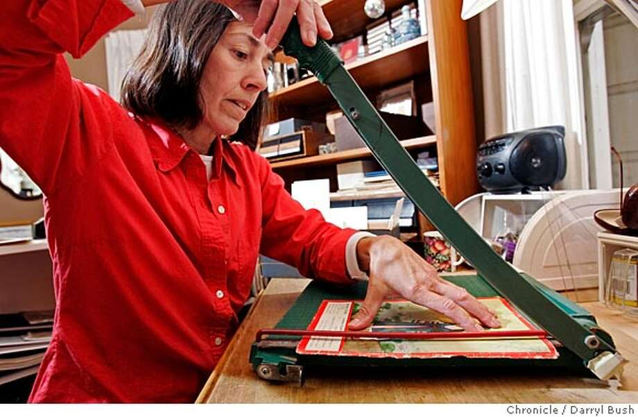 Rosemary Mans makes greeting cards by cutting out illustrations from old books inside her home studio. The cards are then sold with the proceeds going to the Friends of the San Francisco Public Library.  Event on 7/13/05 in San Francisco.  Darryl Bush / The Chronicle Photo: Darryl Bush