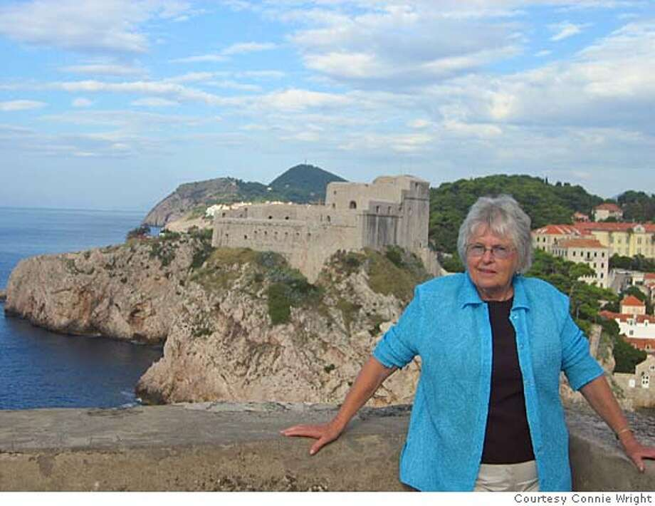 TRAVEL JUSTBACK -- Connie Wright in front of the fort of the old walled city of Dubrovnik.  Connie Wright, Penn Valley  FEB. 4 Email: connie@islandata.com  Daytime phone number: 530-432-8991  Just back from: Dubrovnik, Croatia  I went because: Swedish friends recommended a trip to Dubrovnik and the sunny Croatian coastline, not fully discovered by American travelers.  Don't miss: A walk on the walls of the old city. Also, side trips to many sun-drenched islands, Mostar in Bosnia, and also Montenegro.  Don't bother: Wandering through the Old Town at mid-day, as the streets are crowded with visiting cruise ship passengers. Mornings and late afternoons are quiet.  Coolest souvenir: Small packets of lavender wrapped in mesh. (So easy to pack.) For kids, headbands and shirts from Croatian soccer teams.  Worth a splurge: Hotel Expedia. Right on the Adriatic Sea, with private swimming areas and bars and restaurants overlooking the water.  I wish I'd packed: Small plastic ice cube trays to place in the hotel mini-bars. (Ice machines are nowhere to be seen.)  Other comments: Kayak trips to nearby island (half day to 5 days) are easily arranged locally.  Details of attached photo (if sent): Connie Wright in front of the fort of the old walled city of Dubrovnik. travel_justback_dubrovnik.jpg  9/28/06 in , . Photo: Na