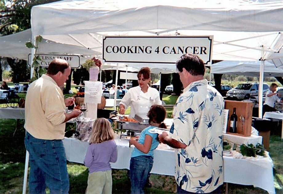 Cindy Rhodes, founder of Cooking 4 Cancer, spreads the word about her foundation at a culinary event.
