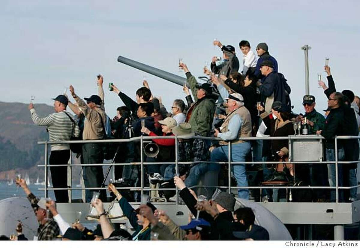 Passengers of the World War II, SS Jeremiah O'Brien toast the Mary II with champaign, as it sails towards the Golden Gate Bridge, Sunday Fe. 4, 2007, in San Francisco, CA. (Lacy Atkins/The Chronicle)