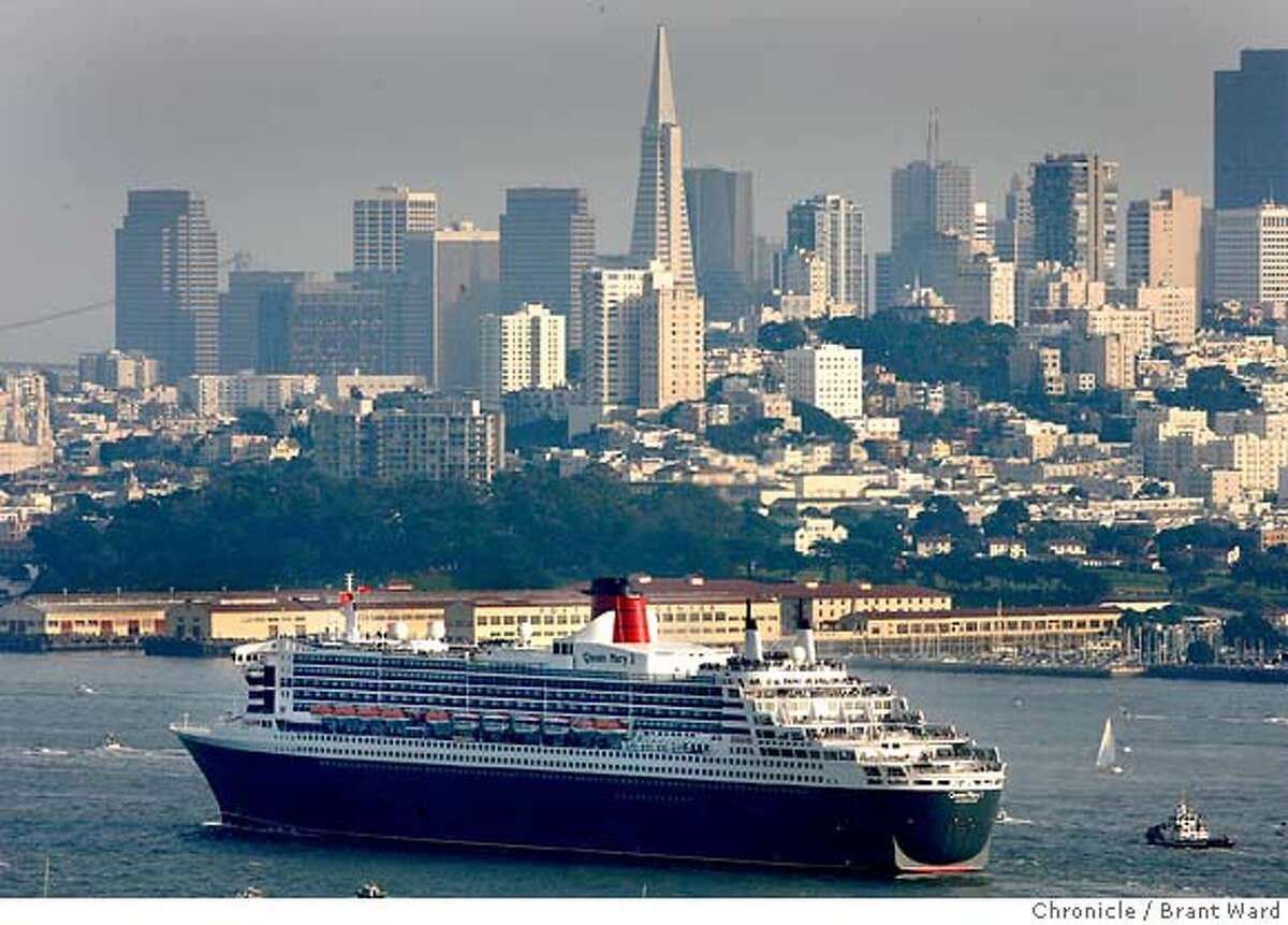 The Queen Mary passed in front of the San Francisco skyline. The Queen Mary 2 sailed under the Golden Gate Bridge to the applause of hundreds of onlookers at the Marin headlands overlook. {Brant Ward/San Francisco Chronicle}2/4/07