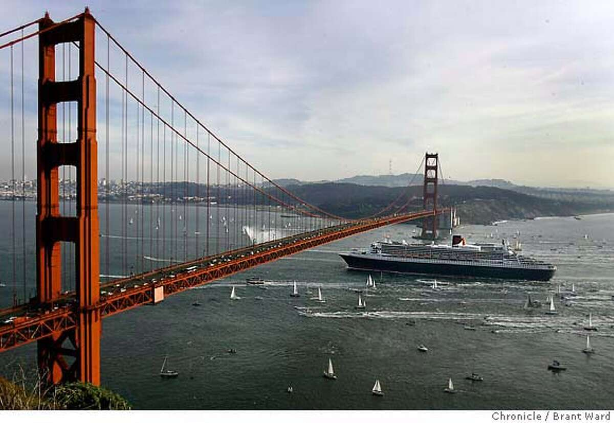 The Queen Mary 2 just nudges under the bridge Sunday to the sound of fog horns. The Queen Mary 2 sailed under the Golden Gate Bridge to the applause of hundreds of onlookers at the Marin headlands overlook. {Brant Ward/San Francisco Chronicle}2/4/07