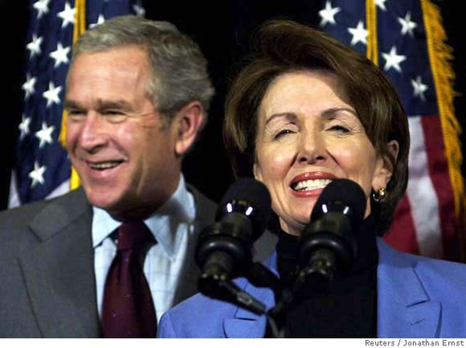 House Speaker Nancy Pelosi (D-CA) (R) smiles as she introduces U.S. President George W. Bush at a news conference at the House Democratic Issues Conference in Williamsburg, Virginia, February 3, 2007. REUTERS/Jonathan Ernst (UNITED STATES)  Ran on: 02-04-2007  Speaker Nancy Pelosi, D-Calif., introduces President Bush in his first visit in 6 years to the Democrats' retreat in Williamsburg, Va. Photo: JONATHAN ERNST
