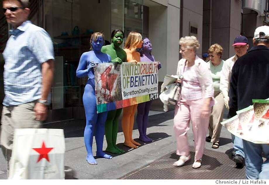 PROTEST30_132_LH.JPG Jodi Ruckley (ca, blue) from Australia, Njeri Sims (cq, green) from San Francisco, Eva Carpinelli (cq, orange) from Italy, and Kristina Hoerler (cq,purple) from San Francisco, are PETA protesters rallying outside Benetton at noon to protest the store's use of Australian wool. Australian farmers use a practice called museling, in which the animal is trussed upside down and, without painkillers, has chunks of its hind area sheared to prevent maggot infestation. Activists are on a world tour. Photographed by Liz Hafalia on 7/29/05 in San Francisco, CA Photo: Liz Hafalia