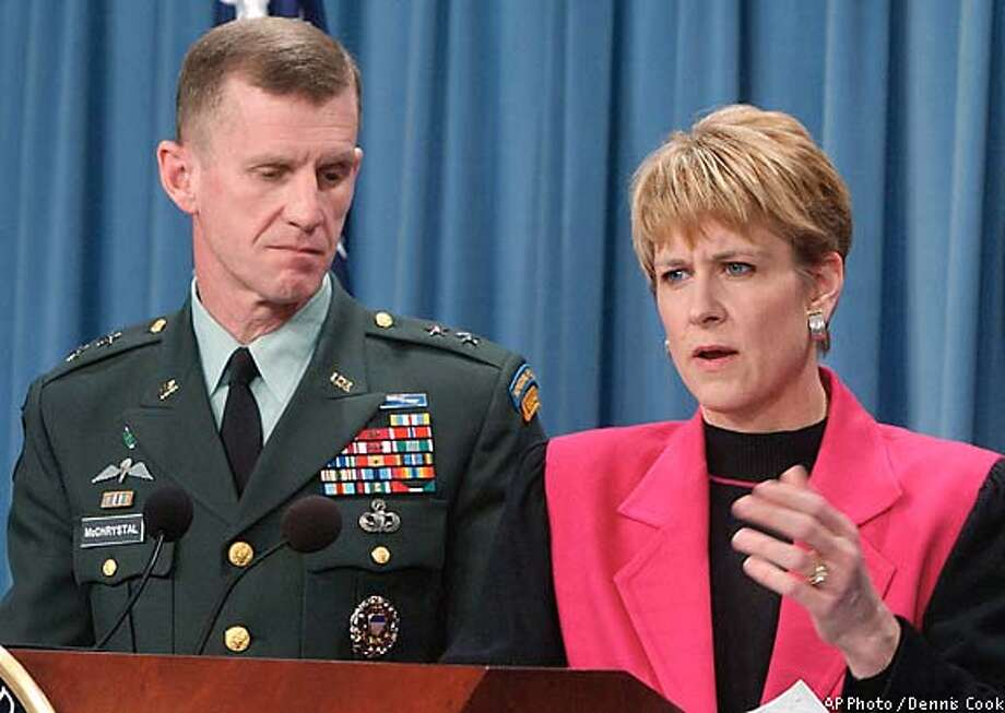 Victoria Clarke, assistant secretary of defense for public affairs, accompanied by Army Major Stanley A. McChrystal. Associated Press photo by Dennis Cook