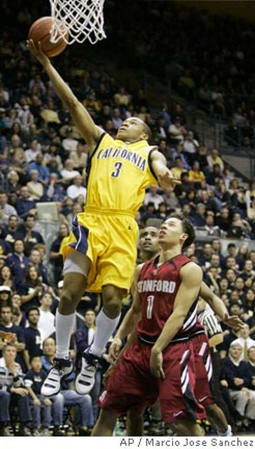 California's Jerome Randle (3) scores past Stanford's Mitch Johnson in the second half of a college basketball game in Berkeley, Calif., Saturday, Feb. 3, 2007.(AP Photo/Marcio Jose Sanchez) Photo: Marcio Jose Sanchez
