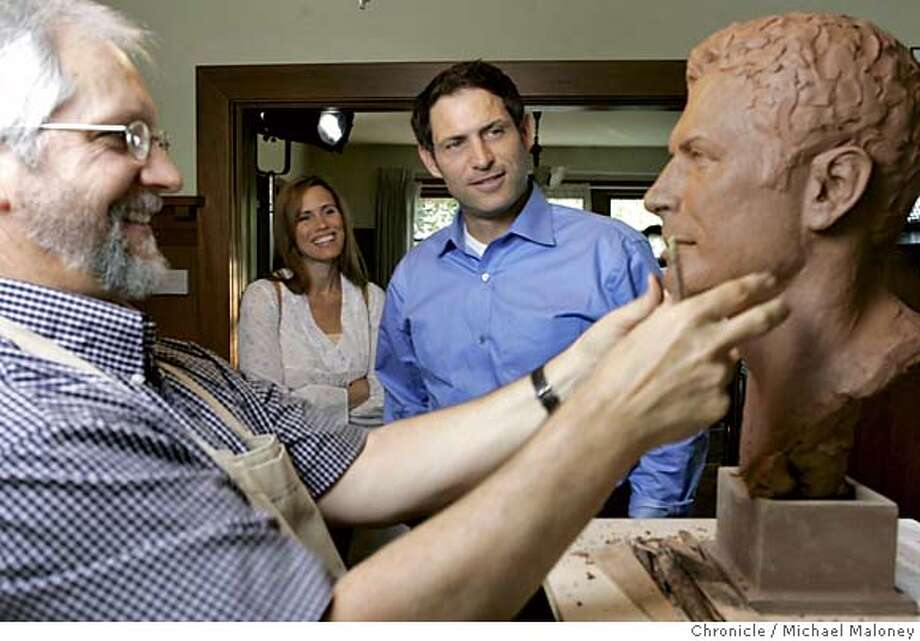 YOUNGSCULPTOR_074_MJM.jpg  Barb and Steve Young take a close look at Blair Buswell's (left) progress.  Blair Buswell is a Utah sculptor doing a Hall of Fame bust of his friend, former 49ers QB Steve Young. Young will be inducted to the Football Hall of Fame later this summer and Buswell was commissioned to create the bust. Young sat for him in one of Young's Palo Alto homes.  Photo by Michael Maloney / San Francisco Chronicle MANDATORY CREDIT FOR PHOTOG AND SF CHRONICLE/ -MAGS OUT Photo: Michael Maloney