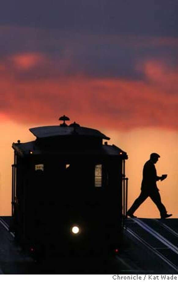 CABLECARart_KW_.jpg STAND ALONE: A man exits a cable car on California Street in San Francisco at commuter time as the sun sets on January 29, 2007. Kat Wade/The Chronicle Mandatory Credit for San Francisco Chronicle and photographer, Kat Wade, Mags out Photo: Kat Wade