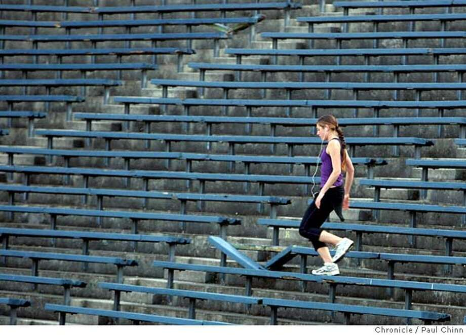 A jogger runs past a broken bench in Memorial Stadium at UC Berkeley on Friday, Jan. 26, 2007. Several lawsuits are delaying the university's renovation and expansion plan for the aging stadium.  PAUL CHINN/The Chronicle MANDATORY CREDIT FOR PHOTOGRAPHER AND S.F. CHRONICLE/ - MAGS OUT Photo: PAUL CHINN