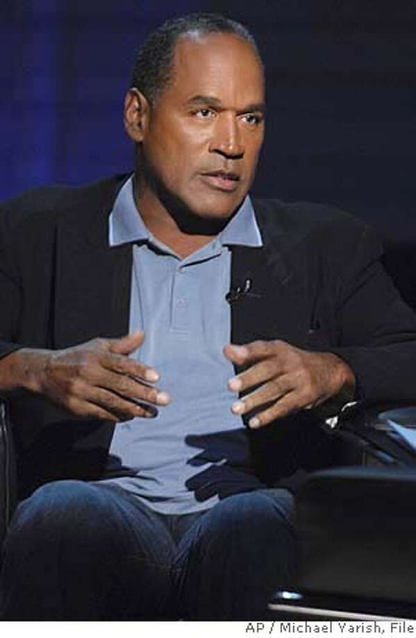 "This undated promotional photo, released by Fox Television, shows O.J. Simpson during an exclusive interview with publisher Judith Regan (not pictured) about how the murders of Nicole Brown Simpson and Ron Goldman would have taken place had he actually committed the crimes. News. Corp. said Monday, Nov. 20, 2006, that it has canceled the companion O.J. Simpson book and television special ""If I Did It."" (AP Photo/Fox, Michael Yarish)  Ran on: 11-21-2006  O.J. Simpson's book, &quo;If I Did It,&quo; will be withdrawn, says the publisher.  Ran on: 11-21-2006  O.J. Simpson's book, &quo;If I Did It,&quo; will be withdrawn, says the publisher.  Ran on: 11-23-2006  O.J. Simpson says, &quo;It's all blood money, and, unfortunately, I had to join the jackals.&quo; ,UNDATED PROMOTIONAL PHOTO RELEASED BY FOX TELEVISION, BEST QUALITY AVAILABLE Photo: MICHAEL YARISH"