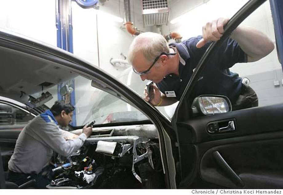 CHRISTINA KOCI HERNANDEZ/CHRONICLE (R)Lee Sorenson watches mechanic, Dinesh Tandel, work.Story is on self-insurance groups for workers comp. To fight the skyrocketing cost of workers comp insurance, small businesses are banding together in industry groups to self-insure. They often cut their bills by 25 to 30%. Lee Sorenson works for Bickmore Risk Services, which helps run a self-insurance group for auto dealers called ADcomp. He will be visiting Team Volkswagen in Hayward on Thursday morning to do a safety appraisal as part of an effort to prevent on-the-job injuries and thus limit workers comp claims. There may be good photo opportunities of Sorenson inspecting the service department of Team VW, if we can get mechanics in action while he is inspecting. Sorenson will be there from 10 am until around noon. Photo: CHRISTINA KOCI HERNANDEZ