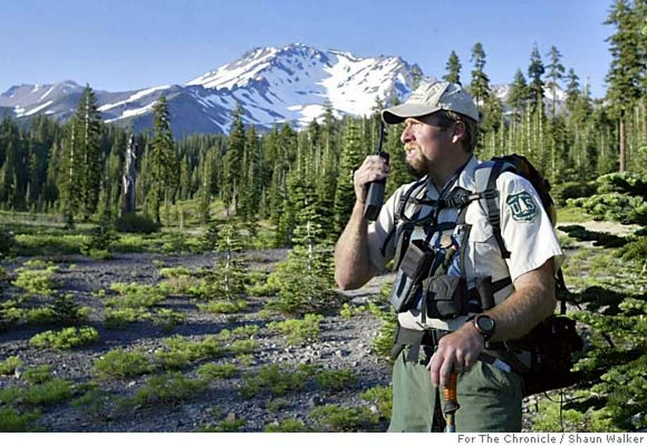 U.S. Forest Service Lead Climbing Ranger Matt Hill talks on his radio at Bunny Flat, about 7,000 feet up Mt. Shasta on Sunday. Photo by Shaun Walker/For The Chronicle Photo: Shaun Walker/For The Chronicle